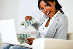 Surprised woman with dollars looking to you Stock Image