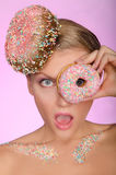 Surprised woman, donut on head and front of eye Stock Image
