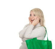 Surprised woman with ecological shopping bag Stock Photo
