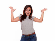 Surprised woman in excitement with arms up Stock Images
