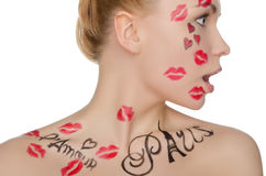 Surprised woman with face art on theme of France Royalty Free Stock Photos