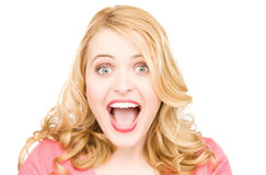 Surprised woman face. Bright picture of surprised woman face over white Stock Photography