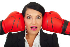 Surprised woman face between two gloves Royalty Free Stock Image
