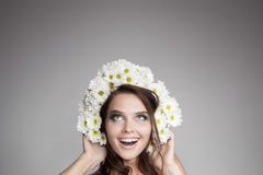 Surprised Woman With Flower Wreath Looking Up At Copy Space Royalty Free Stock Photo