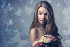 Surprised woman with flowers Stock Photography
