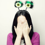 Surprised woman with funny green eyes. Royalty Free Stock Photography