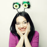 Surprised woman with funny green eyes. Royalty Free Stock Photo
