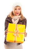 Surprised woman with gift box Royalty Free Stock Images
