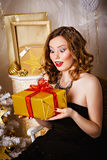 Surprised woman with a gift in her hands Stock Images