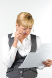 Surprised woman in glasses with documents. Strict businesswoman carefully read the documents Stock Photo