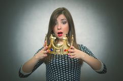 Surprised woman with golden crown. First place concept. Royalty Free Stock Photography