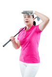 Surprised woman golfer looking where the ball flew away Stock Photography