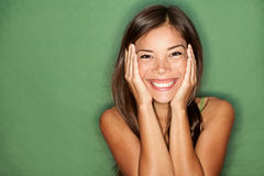 Surprised woman on green background. stock images
