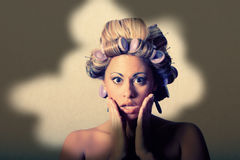 Surprised woman with hairrollers Royalty Free Stock Images