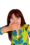 Surprised woman with hand on mouth. Royalty Free Stock Images