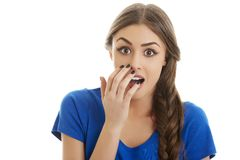 Surprised woman with hand over mouth Royalty Free Stock Images