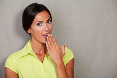 Surprised woman with hand to mouth Royalty Free Stock Images