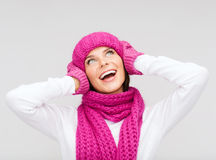 Surprised woman in hat, muffler and mittens Royalty Free Stock Photo