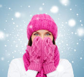 Surprised woman in hat, muffler and mittens Stock Photos
