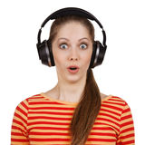 Surprised woman with headphones listening to the muse Royalty Free Stock Image