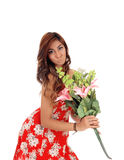 Surprised woman holding big flowers. Royalty Free Stock Photography