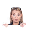 Surprised woman holding a blank sign royalty free stock photos