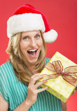 Surprised Woman Holding Christmas Present Royalty Free Stock Image