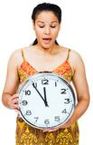 Surprised woman holding clock Royalty Free Stock Photos