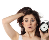Surprised woman holding clock Stock Image
