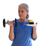 Surprised Woman Holding Dumbbell and Cupcake Royalty Free Stock Photos