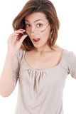 Surprised woman holding eyeglasses and taking a closer look Stock Images