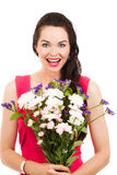 Surprised woman holding flowers Stock Photo