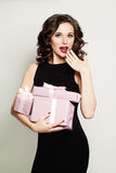 Surprised Woman holding Gift Box Stock Photos