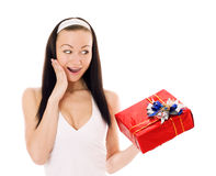 Surprised woman holding a gift box. Royalty Free Stock Photos