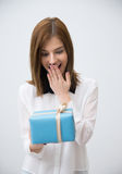 Surprised woman holding gift Stock Photography