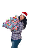 Surprised woman holding heavy Xmas  presents. Surprised woman holding Christmas presents with risk to fall isolated on white background Stock Photography