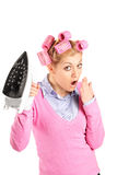 Surprised woman holding an iron Stock Photography