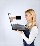 Surprised woman holding a laptop and hand with business card Royalty Free Stock Photo