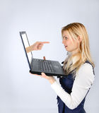 Surprised woman holding a laptop and hand. Concept of luck. Surprised woman holding a laptop and hand stock image