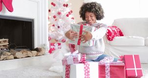 Surprised woman holding a large Christmas gift stock video footage
