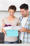 Surprised woman holding many gifts from her partner Royalty Free Stock Photos