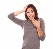 Surprised woman holding mouth and looking at you Royalty Free Stock Photography