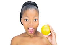 Surprised woman holding orange Royalty Free Stock Images