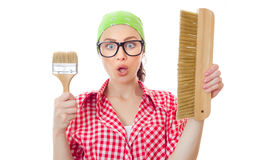 Surprised woman holding paint brush Royalty Free Stock Photos