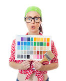 Surprised woman holding paintbrush and color samples. For selection, isolated on white. Female worker choosing a new color for wall in a home Stock Images