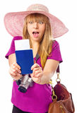 Surprised woman is holding a passport with ticket Royalty Free Stock Image