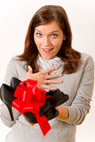 Surprised woman holding present shoes Stock Image