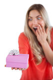 Surprised woman holding a present Stock Image