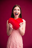 Surprised woman holding red heart Royalty Free Stock Photos