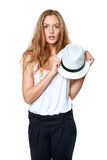 Surprised woman holding straw hat Royalty Free Stock Photography